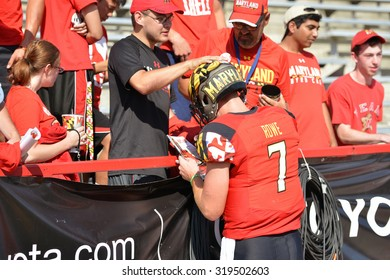 COLLEGE PARK, MD - SEPTEMBER 19: Maryland Terrapins quarterback Caleb Rowe (7) signs an autograph for a fan following a NCAA football game September 19, 2015 in College Park, MD.