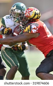COLLEGE PARK, MD - SEPTEMBER 19: South Florida Bulls running back D'Ernest Johnson (32) is hit hard by a Terp defender during a NCAA football game September 19, 2015 in College Park, MD.