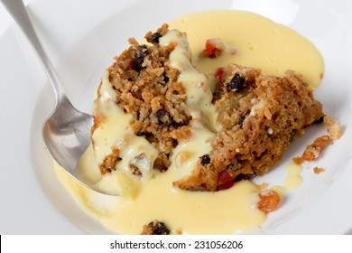 College pudding, the traditional steamed  dessert served to students at Oxford and Cambridge, containing dried fruits, candied peel, flour, sugar, bread, egg and suet served with custard.