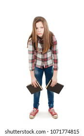 College student bored, frustrated and overwhelmed. Young girl with a backpack on his back holding books in hands. Isolated on white background.