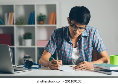 College student doing homework at home