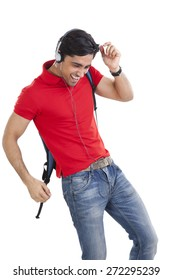 College student enjoying while listening to music