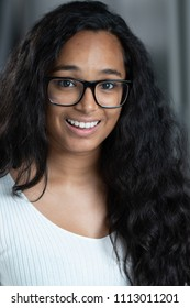 College student with glasses smiling