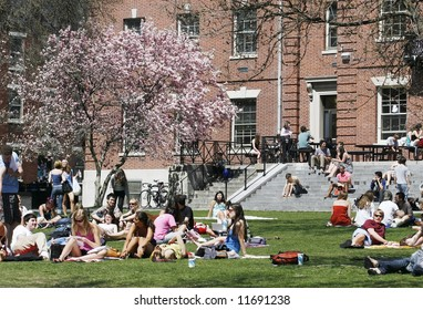 college students enjoying spring weather on campus