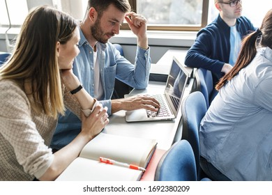 College students listen to professor's lecture in class room.