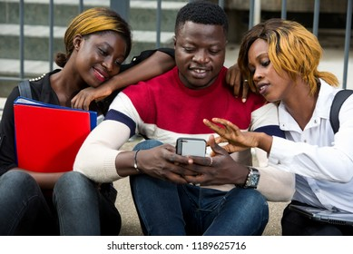 College students together study smiling with tablet, and cellphone at university campus