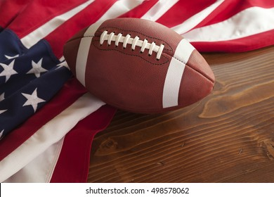 College style football with an American flag on a dark pine wood background
