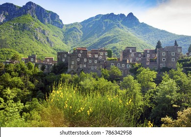 Colletta di Castelbianco, Liguria, Italy - May 20, 2009: View of Colletta di Castelbianco an ancient village in Liguria Italy with mountains in the background