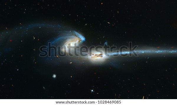 Colliding galaxies,  Mice Galaxies, spiral galaxies in constellation Coma Berenices. Elements of this image furnished by NASA. Retouched image.