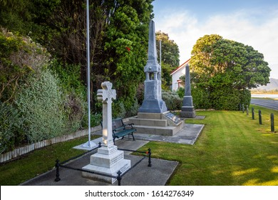 Collingwood, New Zealand - 22 December 2019: The Collingwood Memorial, alongside with a tombstone to Captain Harry Bolton Riley, killed in action 1916, and the Obelisk to the South African (Boer) War