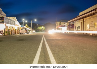 COLLINGWOOD, NEW ZEALAND - OCTOBER 4; main street with double dividing white lines in small town with buildings along roadside  October 4 2018 Collingwood New Zealand.
