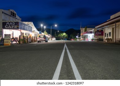 COLLINGWOOD, NEW ZEALAND - OCTOBER 4; main street with double dividing white lines in small town with buildings along roadside October 4 2018 Collingwood New Zealand..
