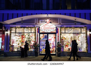 COLLINGWOOD, ON, CANADA - DECEMBER 16, 2017:Christmas store in Blue Mountain Village, People walk near Christmas store, Ontario, Canada