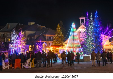 COLLINGWOOD, ON, CANADA - DECEMBER 16, 2018: Christmas light show in Blue Mountain Village at winter night, Ontario, Canada