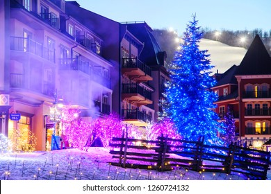 COLLINGWOOD, ON, CANADA - DECEMBER 17, 2018: Christmas decorated Blue Mountain Village in winter night, Ontario, Canada