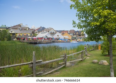 COLLINGWOOD, ON, CANADA - JULY 19, 2017: View of lodging and restaurants at Blue Mountain Village during the summer at Ontario's only four season mountain skii resort.