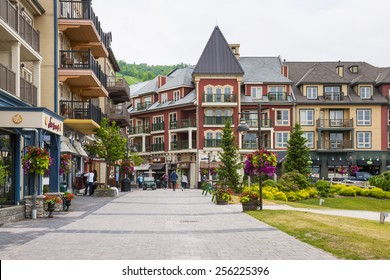 COLLINGWOOD, ON, CANADA - JUNE 18: Shops and restaurants on pedestrian street at Blue Mountain Village in summer, 2014