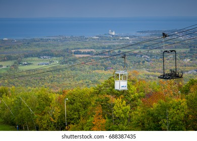 COLLINGWOOD, ONTARIO, CANADA - SEPTEMBER 18, 2016 : Scenic views in autumn landscape above Blue Mountain Ski Resort with a Gondola bearing the resort branding