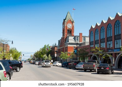 COLLINGWOOD, ONTARIO - MAY 28, 2014: Hurontario street, the main shopping street in Collingwood, Ontario with the clock tower and a harbor lighthouse in the distance