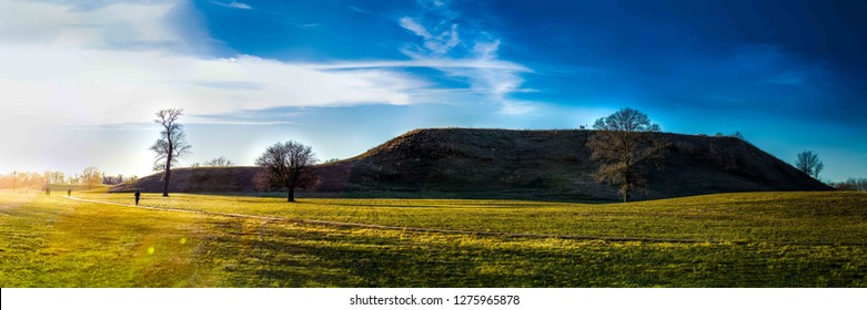 Collinsville, IL--Jan 5, 2018; Sunset at Monks Mound with silhouettes of visitors at the largest earthen structure at the Cahokia Mounds Pre-Columbian ruins complex in southern Illinois