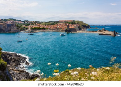 COLLIOURE, FRANCE - JUNE 26: Tourists enjoy the beach of this coastal village in the south of France, Mediterranean sea, Languedoc Roussillon, Pyrenees Orientales