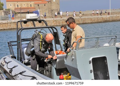 COLLIOURE, FRANCE - SEPTEMBER 5, 2018: divers preparing on a boat in the port of Collioure to go to sea dive