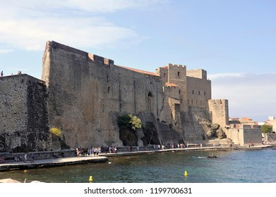 COLLIOURE, FRANCE - SEPTEMBER 5, 2018: Collioure and its Royal castle by the sea giving a fortified air to the city