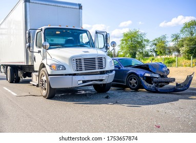 Collision of a semi truck with box trailer a passenger car on the highway road, as a result of which both cars were damaged, await the arrival of the police to draw up an accident report
