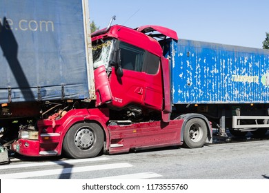 The collision of two trucks in Latvia, next to Olaine, on the A8 road, on August 23, 2018.The truck driver Iveco braked sharply, the driver of Scania did not observe the distance and hit Iveco