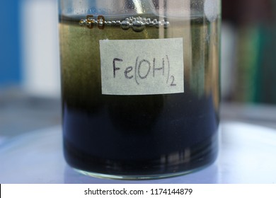 A colloidal solution of iron hydroxide particles that settle on the bottom of a beaker.