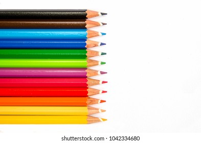 Collor wooden pencils in row isolated on white background. Top view with copy space.