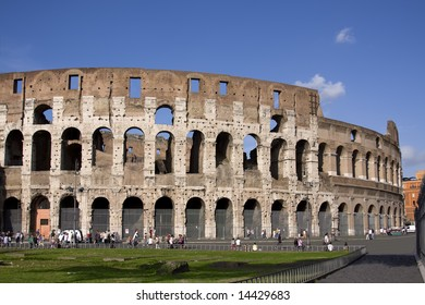 Colloseum with green grass over blue sky