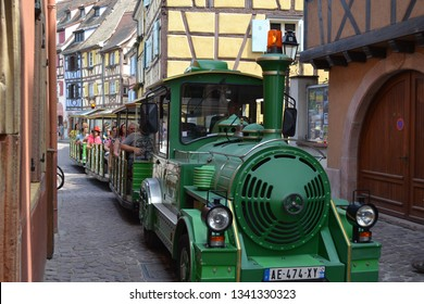 Colmar, Alsace / France - 07/19/2017: Vintage tourist train on the streets of Colmar
