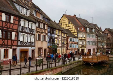 COLMAR, ALSACE, FRANCE - DECEMBER 2014: colorful traditional French houses on the side of river Lauch in little Venice, Colmar, France
