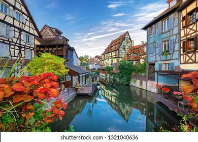 Colmar, Alsace, France. Petite Scenic view on water canal and traditional half timbered houses at sunrise.