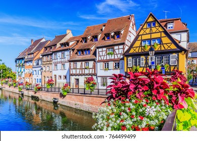 Colmar, Alsace, France. Petite Venice, water canal and traditional half timbered houses.