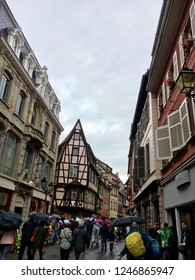 Colmar, France - 1. October 2016. Panorama of the central street in Colmar. Facades of traditional half-timbered houses. Tourists in the historical district of the town.