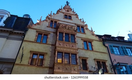 Colmar / France - 12 16 2018: grotesque House of Heads in Colmar during traditional christmas markets in charming town of Colmar in Alsace region, France, Europe