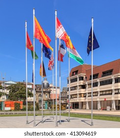 Colmar, France - 18 July, 2014: flags on Place Rapp square. Colmar is the third-largest commune of the Alsace region in north-eastern France, renowned for its well preserved old town.