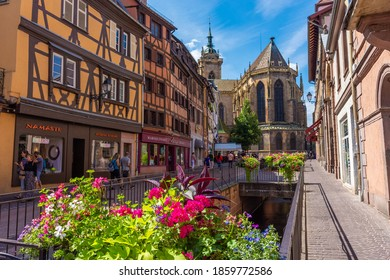 COLMAR, FRANCE, 18 JULY 2020: Cathedral of Colmar at the end of the typical street