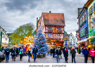 Colmar, France - 4 December 2017: Traditional Alsatian half-timbered houses Christmas  decorated city Colmar in Alsace.