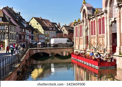 COLMAR, FRANCE - APRIL 18, 2019. The little Venice of Colmar - is a picturesque old tourist area in the historic center. View of the Marche Couvert Market. Town of Colmar, Haut-Rhin, Alsace, France.
