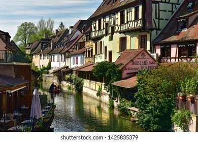 COLMAR, FRANCE - APRIL 18, 2019. Romantic boat trip along the canal in the little Venice of Colmar. Town of Colmar, Haut-Rhin, Alsace, France.