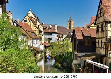 COLMAR, FRANCE - APRIL 18, 2019. The little Venice of Colmar - is a picturesque old tourist area with beautiful canals and traditional half-timbered houses. Town of Colmar, Haut-Rhin, Alsace, France.