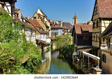 COLMAR, FRANCE - APRIL 18, 2019. The little Venice of Colmar - is a picturesque old tourist neighborhood with beautiful canals and traditional half-timbered houses. Colmar, Haut-Rhin, Alsace, France.