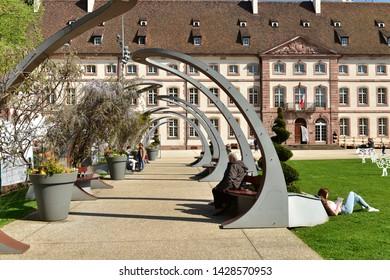 COLMAR, FRANCE - APRIL 18, 2019. Public park in front of the Building of the Edmond Gerrer municipal library. Sguare de la Montagne Verte, Town of Colmar, Haut-Rhin, Alsace, France.