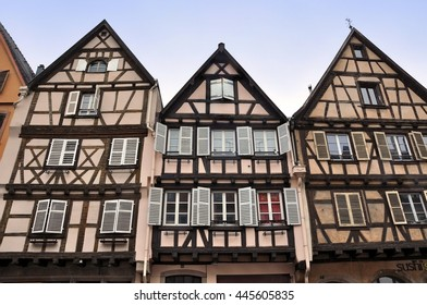 COLMAR, FRANCE - April 23, 2016: Front view of three old typical half-timbered houses, Alsace.