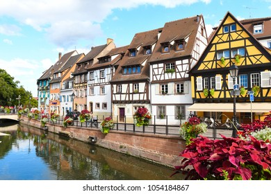 Colmar, France - August 19, 2017: Colorful buildings characterize the quaint town of Colmar, France on a summer day