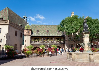 COLMAR, FRANCE - AUGUST 21: People sit at oldest Colmar winery and walk on the square at Tanners district on August 21, 2016 in Colmar, France