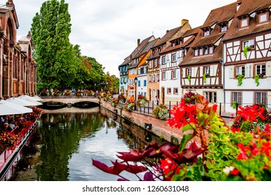 Colmar, France - August 24, 2018: Traditional colorful half-timbered buildings line the canals in the historic Little Venice district of Colmar, France